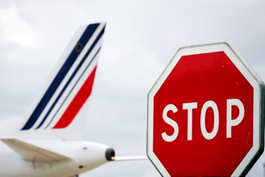 A picture taken on June 1, 2012 shows the tail section of an Air France plane at the Roissy-Charles de Gaulle airport in Roissy-en-France, outside Paris. France's new Socialist government said on May 31, 2012, that it opposed a 400,000 euro ($496,000) severance bonus paid to former Air France-KLM chief Pierre-Henri Gourgeon and urged him to return it. AFP PHOTO/JOEL SAGET