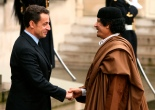 France's President Nicolas Sarkozy (L) greets Libyan leader Muammar Gaddafi in the courtyard of the Elysee Palace in Paris as he arrives for a five day official visit December 10, 2007.      REUTERS/Jacky Naegelen (FRANCE) - RTX4LKO